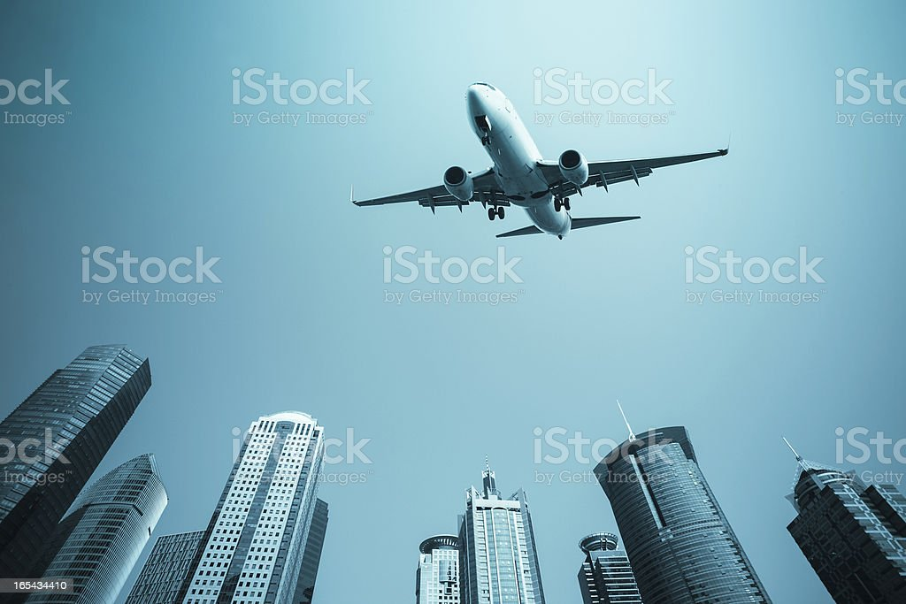 airplane with modern buildings skyline royalty-free stock photo