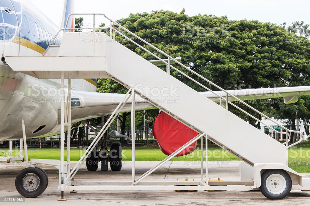 Airplane  with passenger stairs stock photo