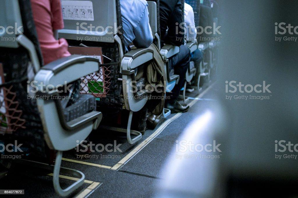 Flugzeug mit Passagieren auf Sitze – Foto