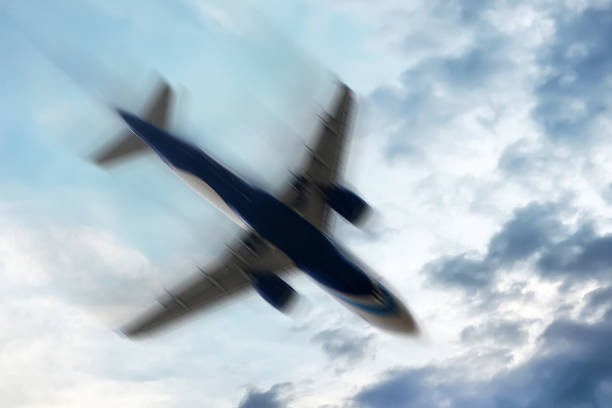Airplane with problems : Concept - Blurred motion. stock photo
