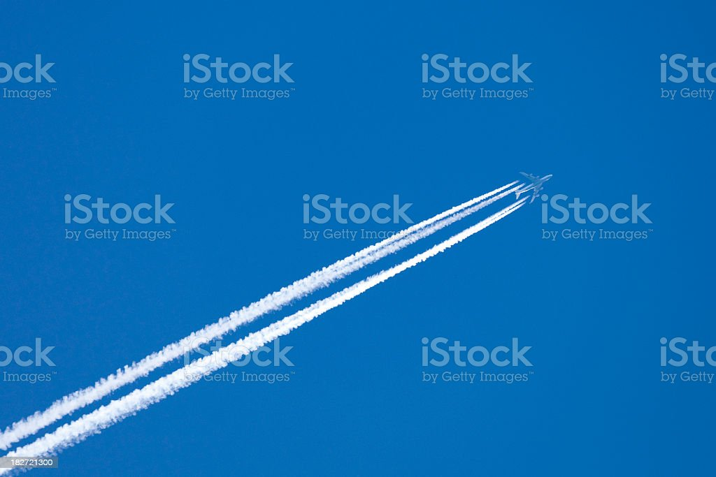 Airplane with vapor stripes royalty-free stock photo