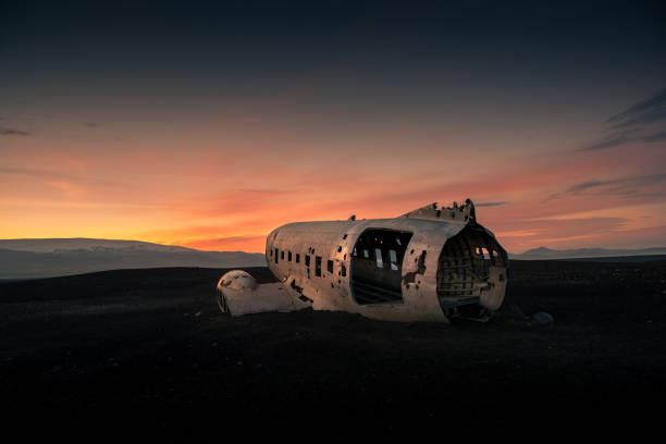 Airplane wreck on a black beach at the sunset. Iceland Airplane wreck on a black beach at the sunset. Iceland sólheimasandur stock pictures, royalty-free photos & images