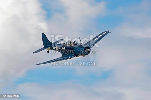 Chino, California,USA - May 7,2017. SBD Dauntless WWII war bird flying at the 2017 Planes of Fame Airshow in Chino, California. The 2017 Planes of Fame Airshow features vintage WWII war birds and various jet aircraft including the modern F-35 Lightning stealth fighter flying for the general public.