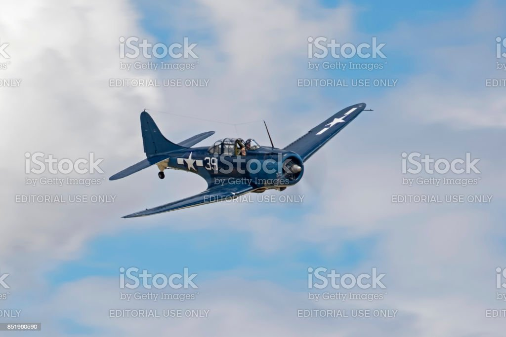 Airplane WWII SBD Dauntless bomber aircraft flying at the airshow stock photo