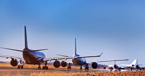 Airplanes 5 runway ground stock photo