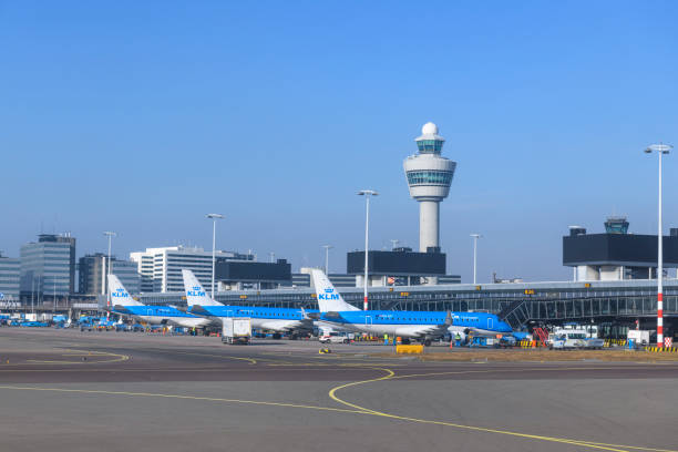 Airplanes at Amsterdam Schiphol airport in Holland stock photo
