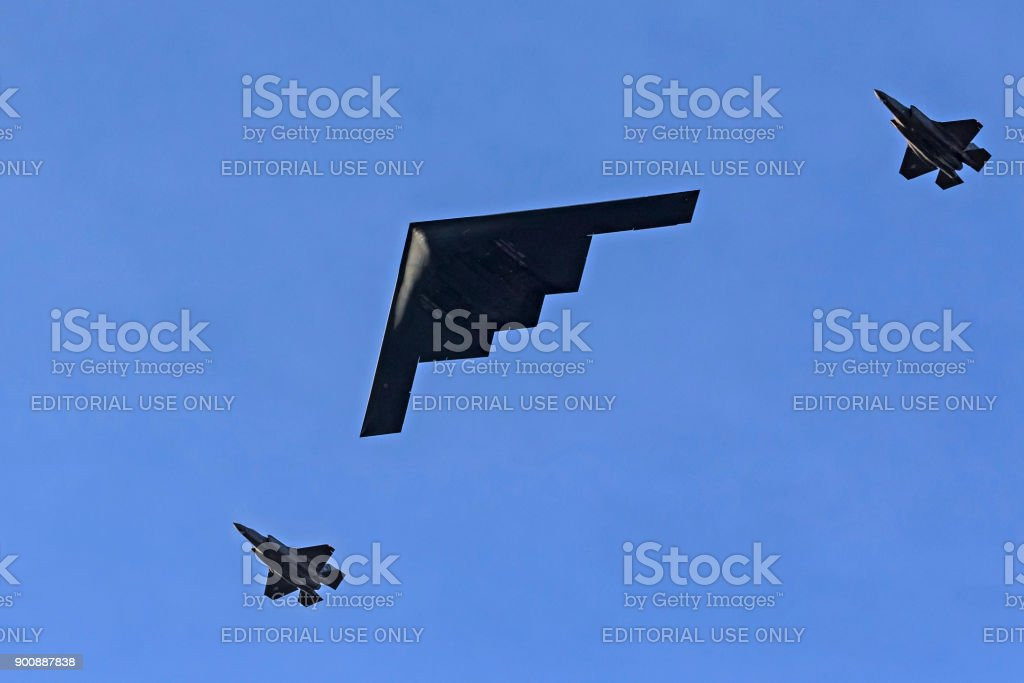 Airplanes B-2 bomber and pair of F-35 Lightning jet fighters flying over the 2018 Tournament of Roses Parade in Pasadena, California stock photo