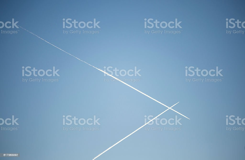 Airplanes crossing paths in the air stock photo