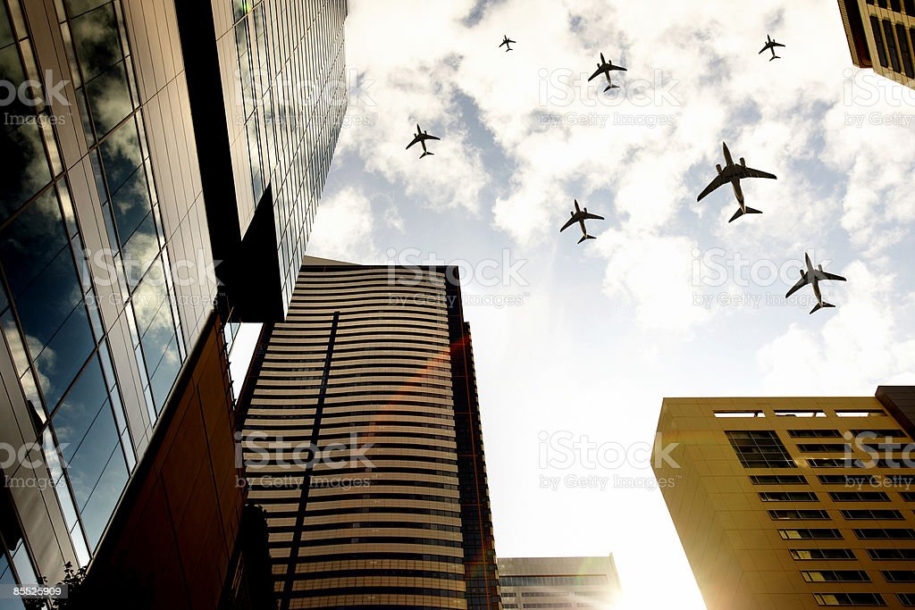 Airplanes flying over buildings royalty-free stock photo
