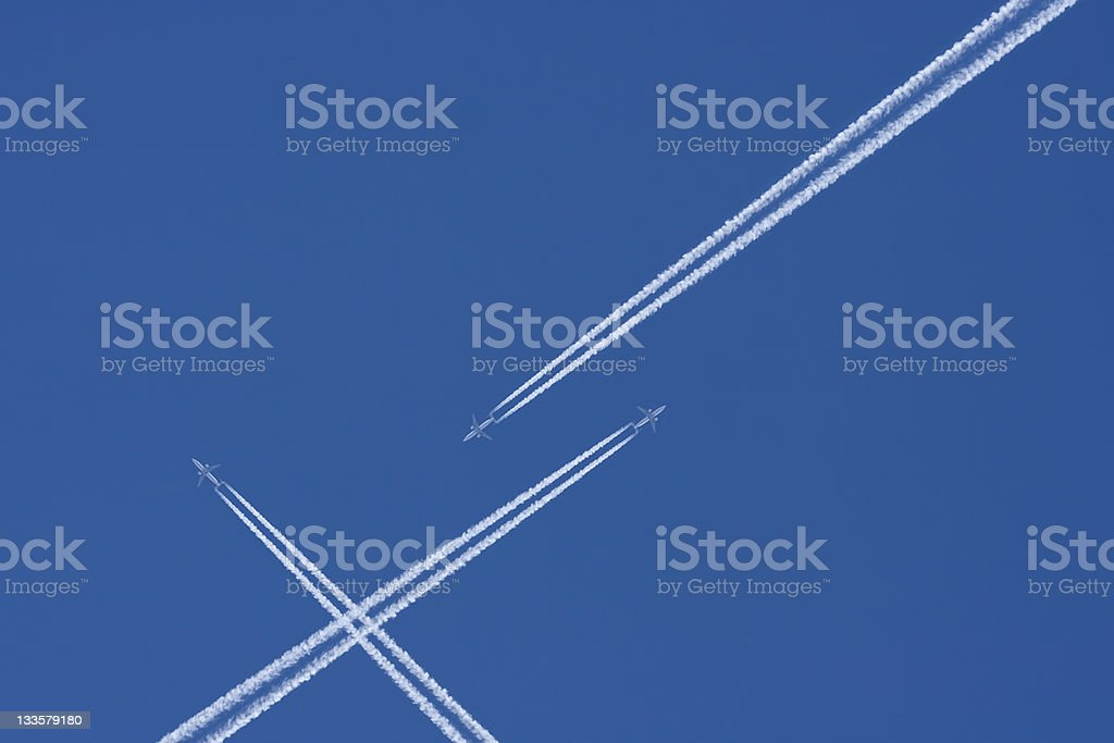 Airplanes in a Blue Sky with Vapor Trail, Air Traffic royalty-free stock photo