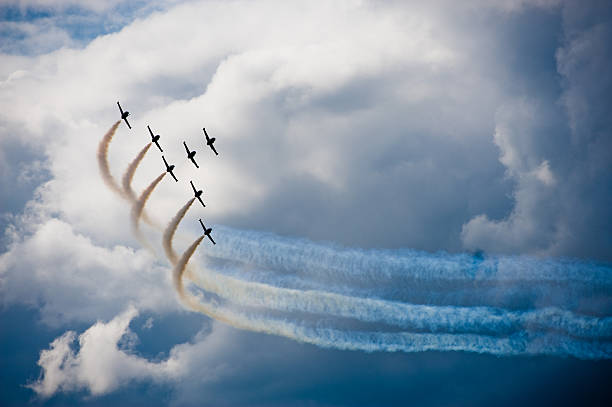 airplanes in a flight show - airshow stock photos and pictures