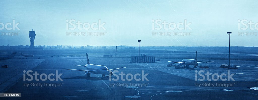 airplanes in barcelona airport stock photo