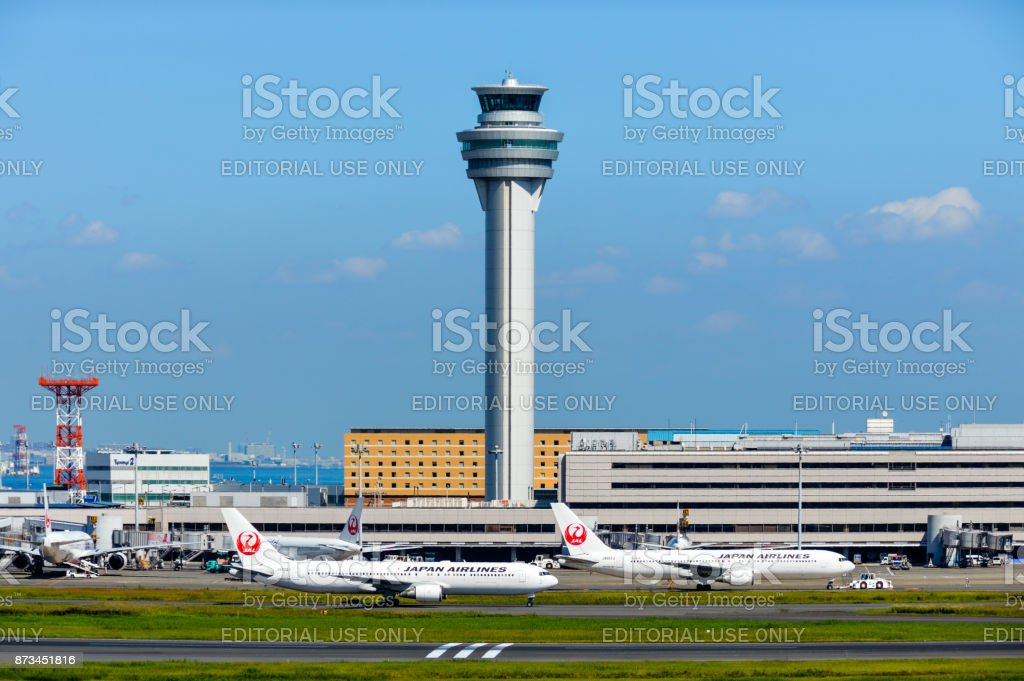 Airplanes line up at Tokyo Haneda Airport stock photo