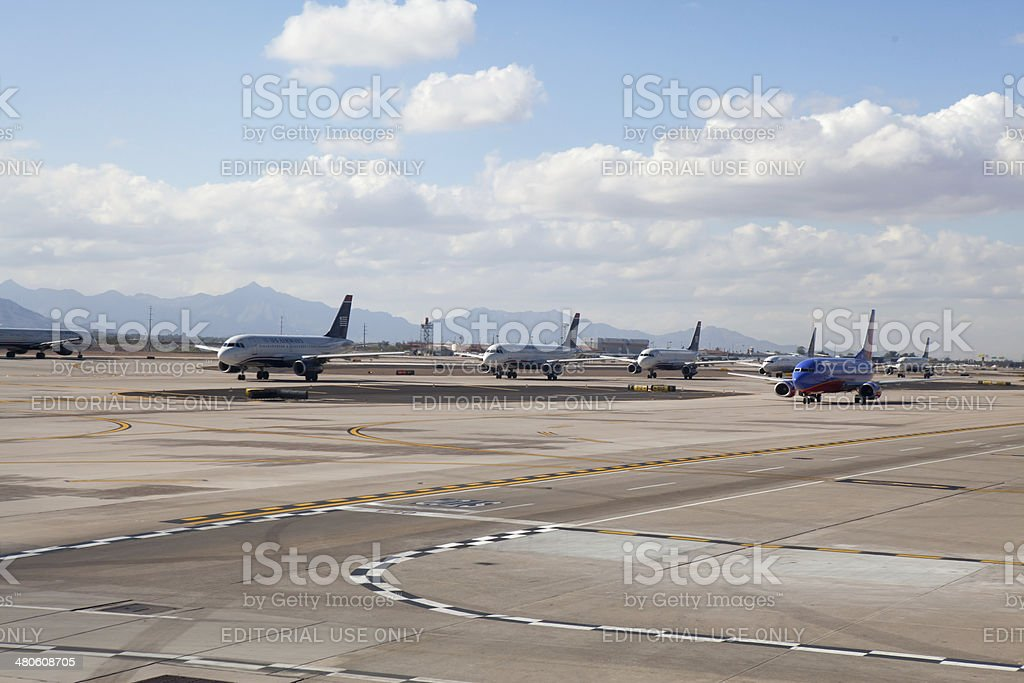 Airplanes lined up on the runway at Phoenix's airport stock photo