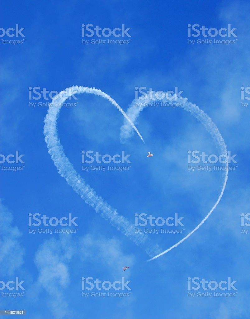 Airplanes making a heart in the sky stock photo
