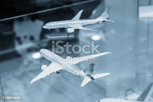 Airplanes on reflective surface with blue tone