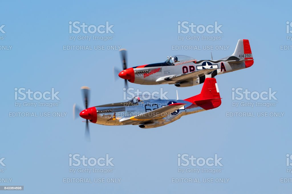 Airplanes pair of P-51 Mustang WWII aircraft flying close formation stock photo