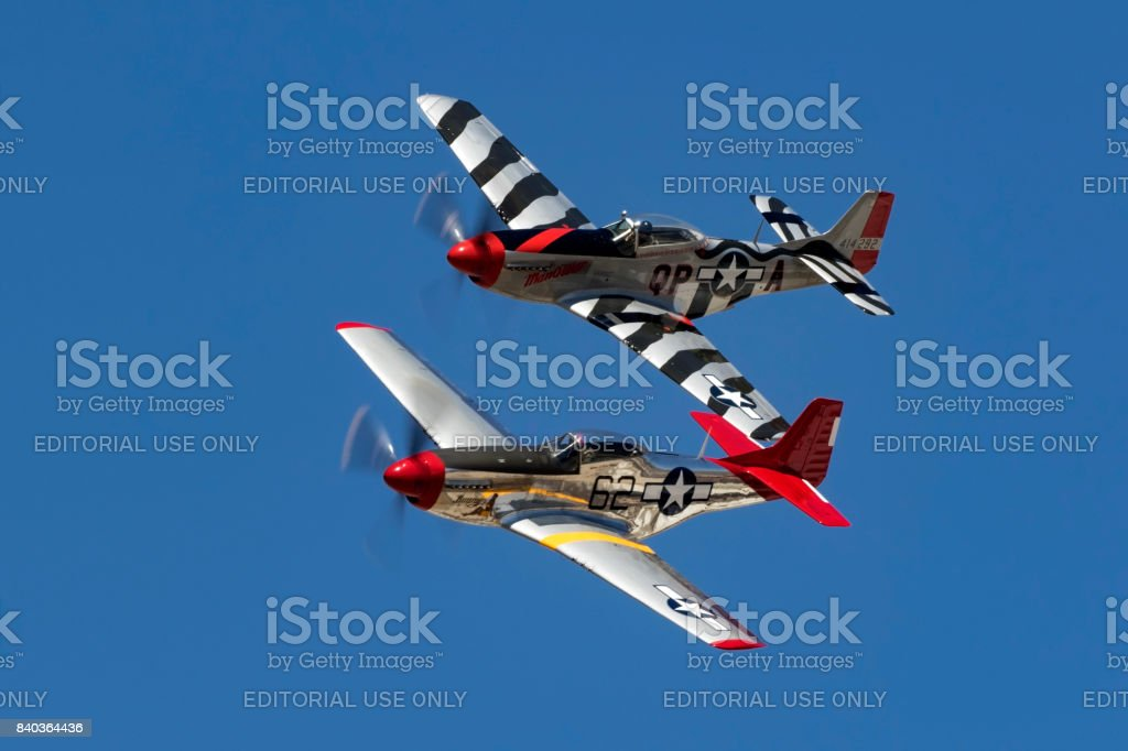 Airplanes pair of vintage WWII P-51 Mustangs stock photo
