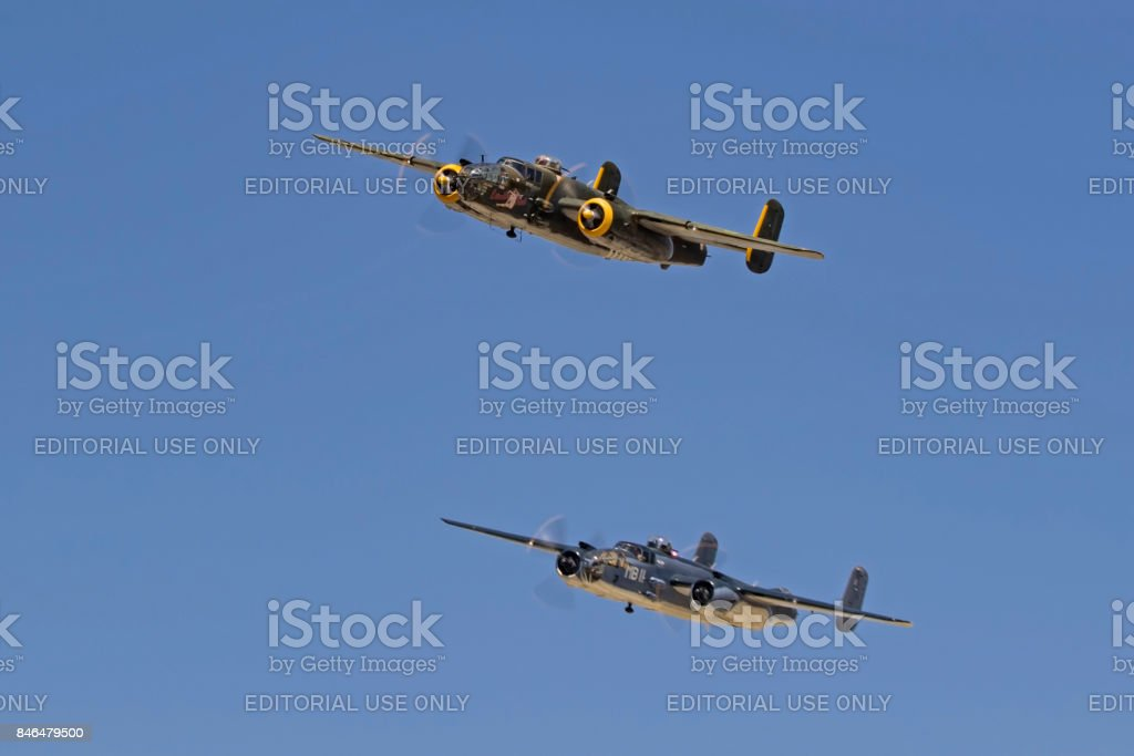 Airplanes pair of WWII B-25 Mitchell bombers flying in formation stock photo