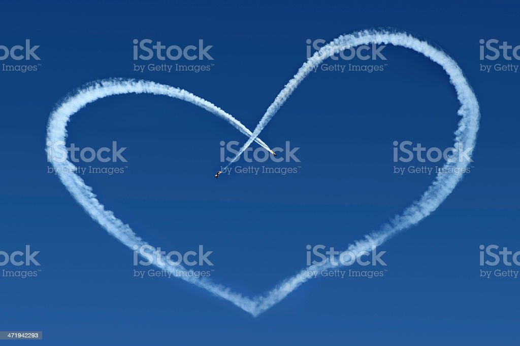 Airplanes Skywriting a Heart royalty-free stock photo