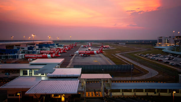 KLIA Airport Air Asia sunset Took the shots on 16 Oct 2019 while came back to Kuala Lumpur KLIA 2 airport during the sunset hour ,while all the plane ready for departure on the sunset hour ,I was was standing at the outdoor corridor watching the beautiful sky and all the plane on the track kuala lumpur airport stock pictures, royalty-free photos & images