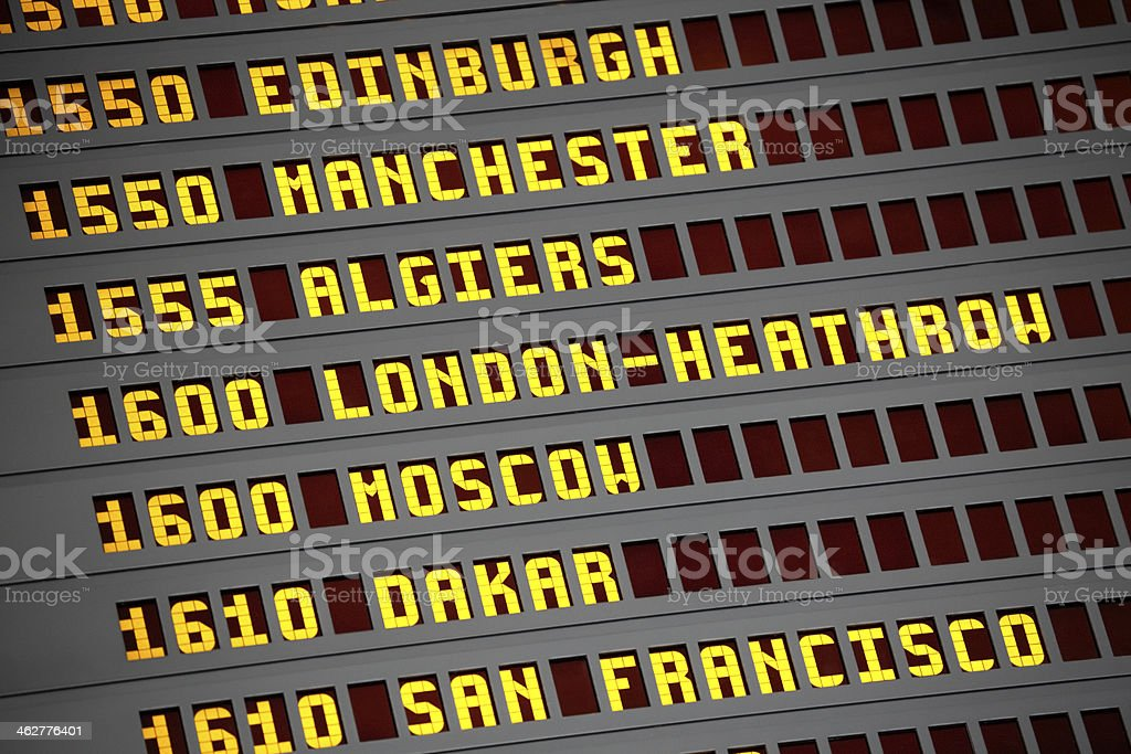 Airport arrivals and departures board stock photo