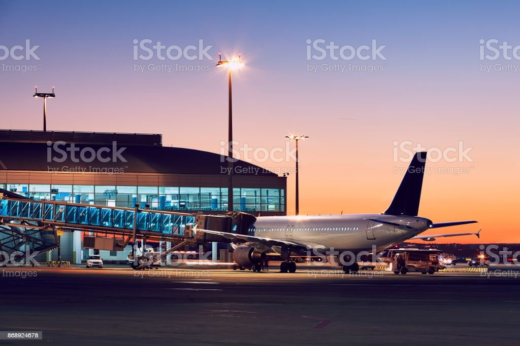 Airport at the colorful sunset stock photo