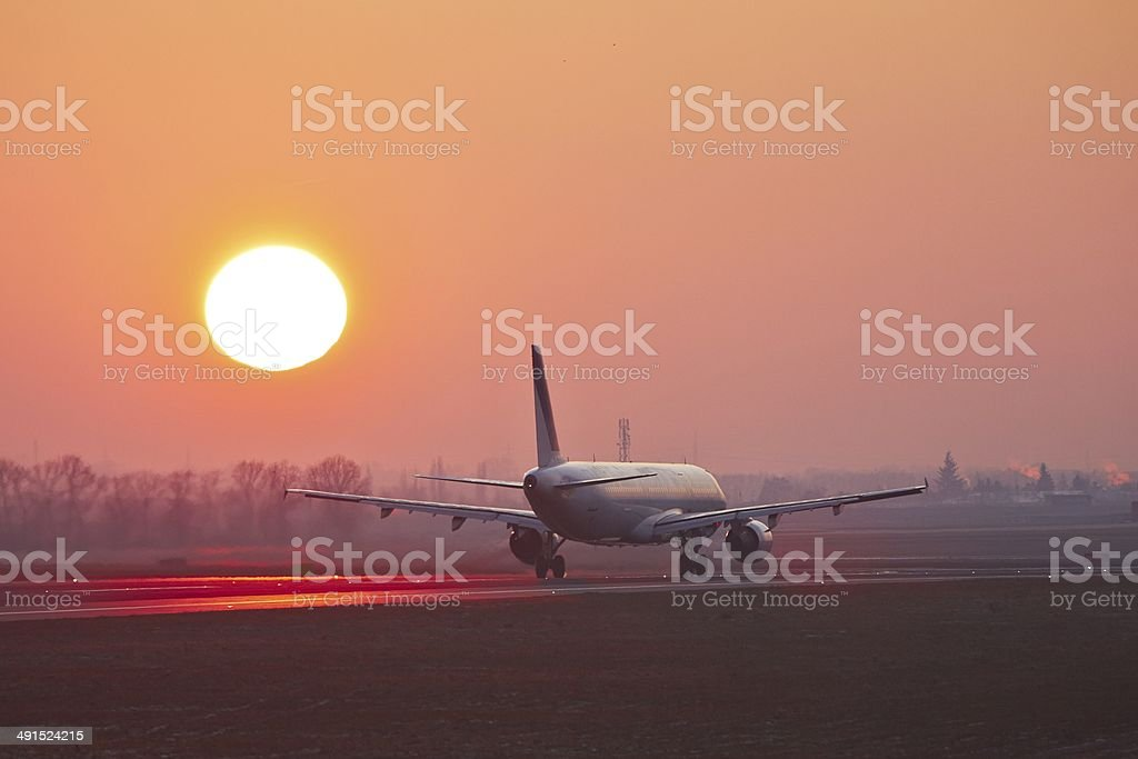 Airport at the sunset stock photo