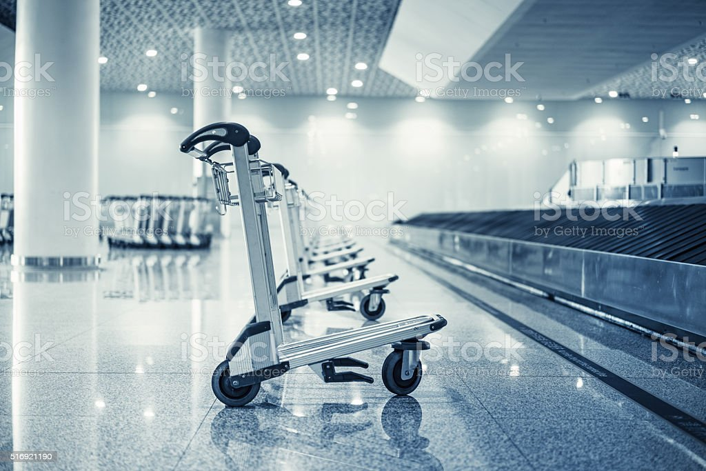 Airport baggage claim area with Trolleys stock photo