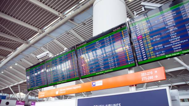 Airport billboard panel with cancelled flights during coronavirus covid-19 epidemic crisis in Warsaw airport. stock photo