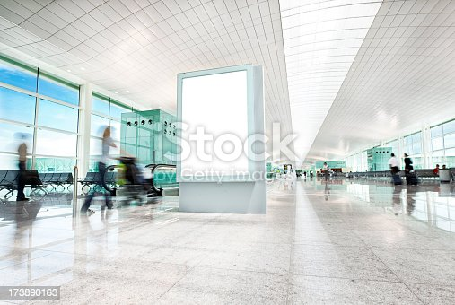 billboard on Barcelona airport and people walking