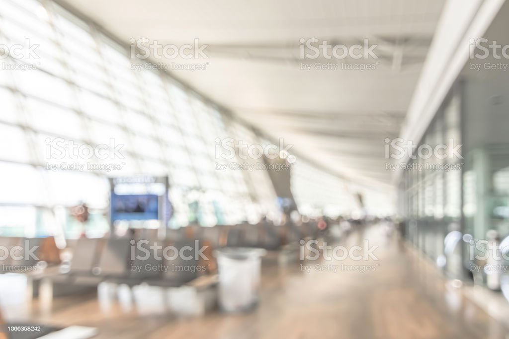 Airport Blur Background For Air Transportation Travel Concept With Blurry Bench  Seats For Traveller Or Tourist