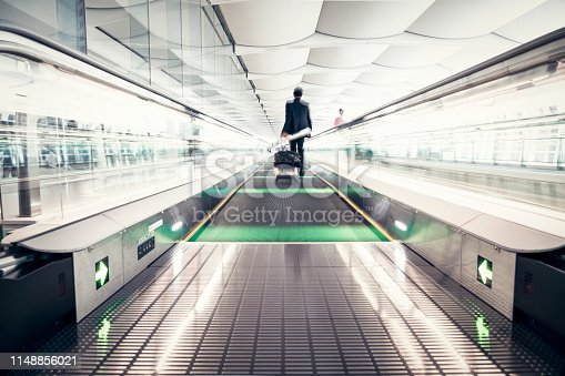 istock Airport Business Travel in Blurred Motion 1148856021