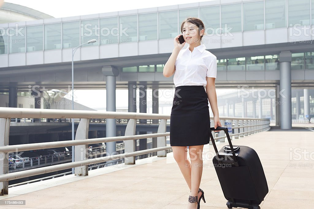 Airport business woman with cellphone royalty-free stock photo