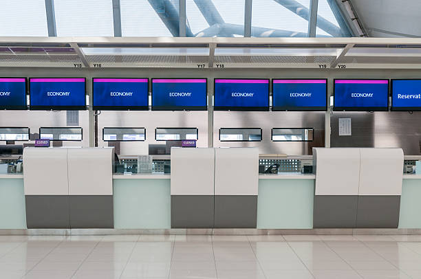 airport check in counters - airport check in counter stock pictures, royalty-free photos & images