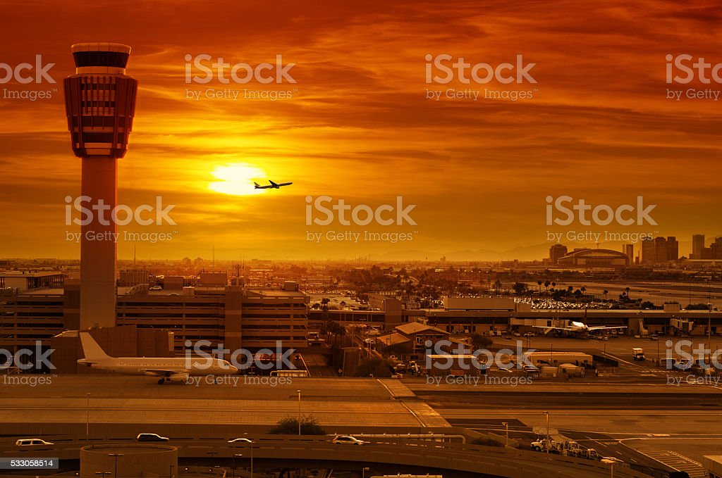 airport control tower at sunset stock photo