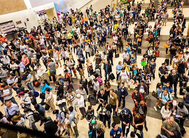 Airport Crowd at Singapore Changai Airport stock photo
