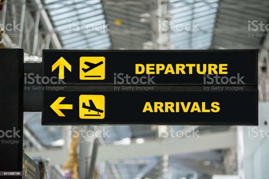Airport Departure & Arrival board sign in terminal at airport. stock photo