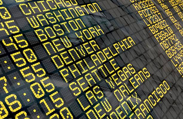 airport departure board with usa destinations - arrival departure board stock photos and pictures