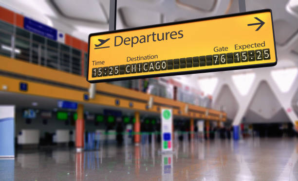 Airport departures board going to Chicago stock photo