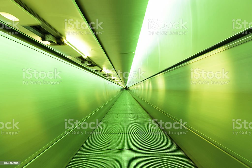 Airport Elevated Walkway Lime Green Illuminated Tunnel royalty-free stock photo