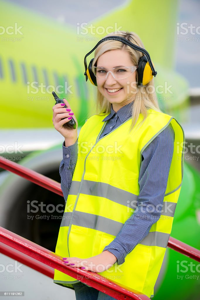 Airport female worker stock photo