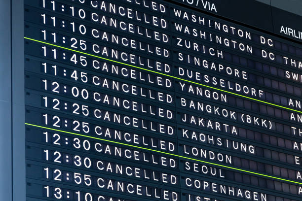 Airport Flight Information Board With Cancelled Flights stock photo