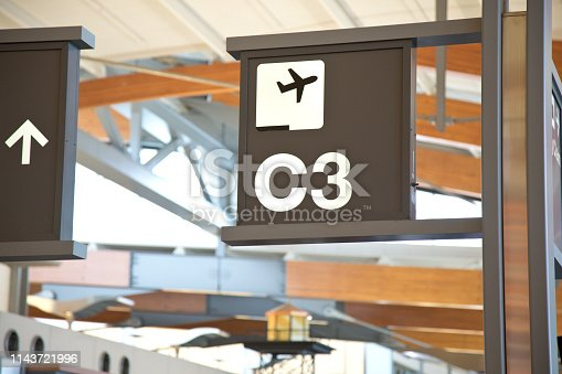 istock Airport gate sign and symbol of jet 1143721996