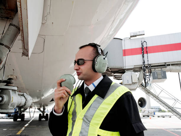 Airport ground control worker stock photo