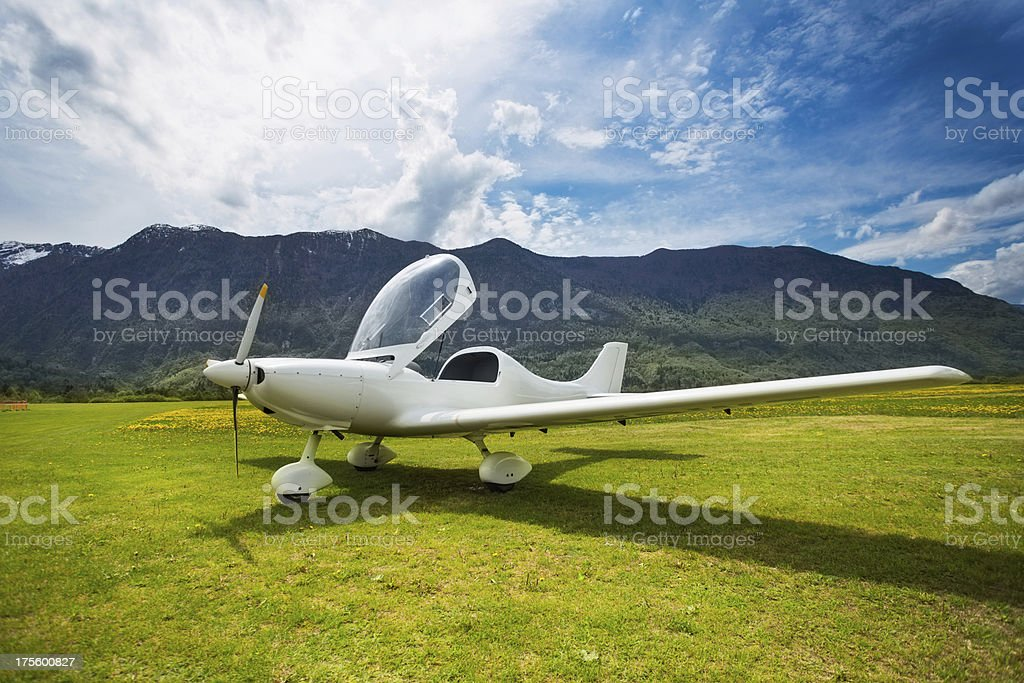 Airport in the mountains..Bovec,Slovenia.Small aircraft just landed. stock photo