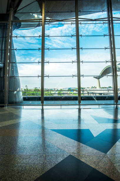 KUALA LUMPUR - 2016 APRIL 23: airport interior in Kuala Lumpur, Malaysia. Airport interior with big window and blue sky KUALA LUMPUR - 2016 APRIL 23: airport interior in Kuala Lumpur, Malaysia. Airport interior with big window and blue sky kuala lumpur airport stock pictures, royalty-free photos & images