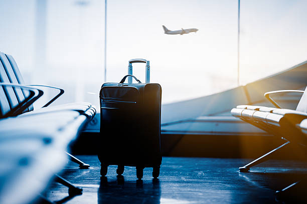 airport interior with flying airplane outside stock photo