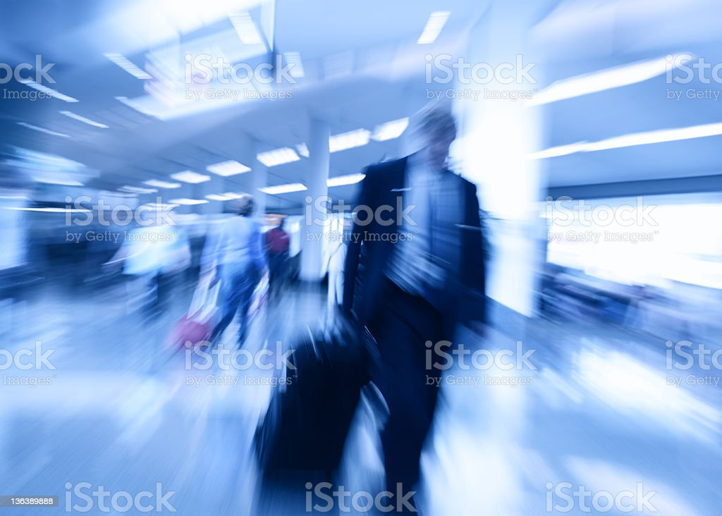 airport lobby abstract business rush men with suitcase in hurry royalty-free stock photo