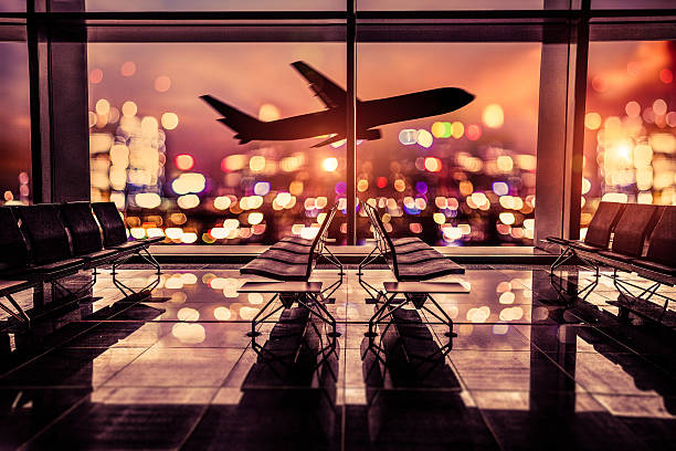 airport lounge and airplane take off in the city - airport terminal stock photos and pictures